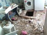 Спуск в подвал разрушенного дома Светланы, где жена и дети Михаила прятались от бомбёжек